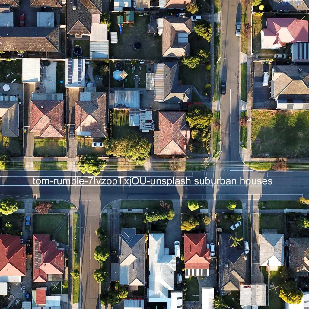 birdseye view of suburban houses at two T-intersections